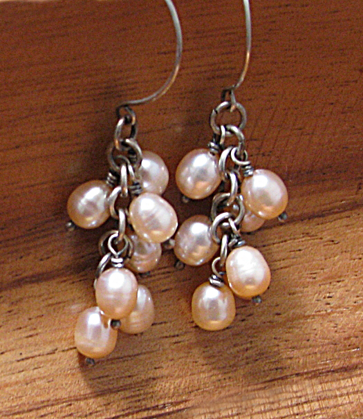 A cascade of pink freshwater pearls wrapped with sterling silver.